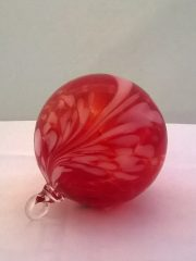 red with white feather ornament